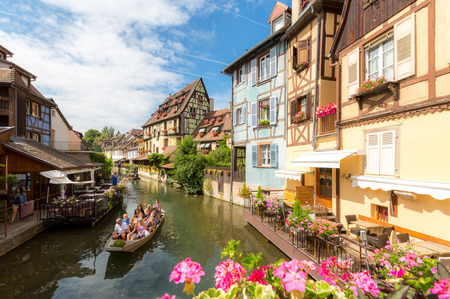 colmar: Colmar, Petit Venice, water canal and traditional colorful houses. Alsace, France. Long exposure.