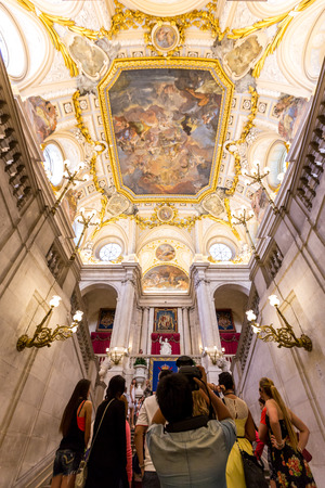 homage: MADRID, SPAIN - JUN 7: The vaulted ceiling and the fresco Corrado Giaquinto Spain Pays Homage to Religion and to the Church in the Royal Palace of Madrid on June 7, 2014. It is popular tourist attraction.