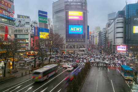 implementations: TOKYO - FEB 18: Pedestrians cross at Shibuya Crossing on Febuary 18, 2015 in Tokyo, Japan. The crosswalk is one of the worlds most famous implementations of a scramble crosswalk.
