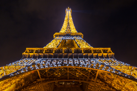 newsworthy: Paris - MAR 14: Eiffel Tower illumination Show on March 14, 2015. Eiffel Tower is the highest monument in France use 20,000 light bulbs in the show.