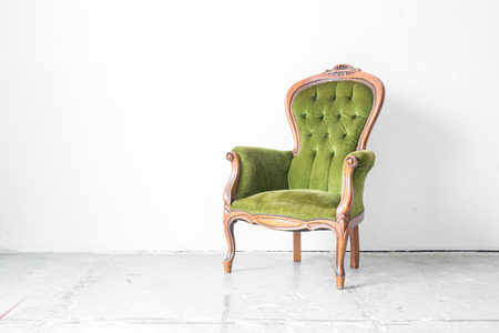 green sofa: Green classical style Armchair sofa couch in vintage room