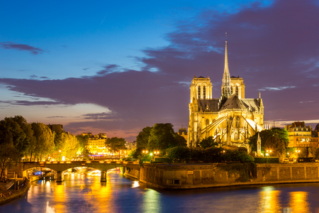 paris at night: Notre Dame Cathedral with Paris cityscape and River Seine at dusk, France Stock Photo