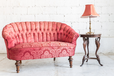 red sofa: Red sofa couch in vintage room with lamp - classical style