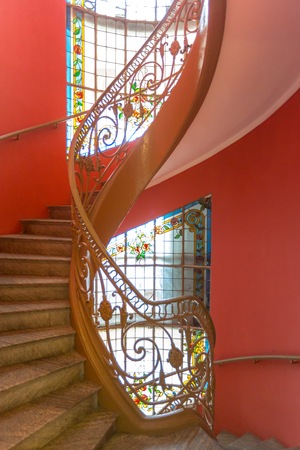 colonial house: Interior spiral staircase in Red building