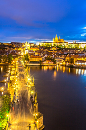 st charles: Pargue at dusk, view of the Lesser Bridge Tower of Charles Bridge Karluv Most and Prague Castle, Czech Republic.