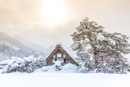 chubu: Shirakawago with Snowfall and winter Sun,  Gifu Chubu Japan Stock Photo