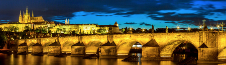 st charles: Pargue at dusk, view of the Lesser Bridge Tower of Charles Bridge (Karluv Most) and Prague Castle, Czech Republic.