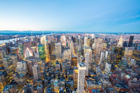 Aerial New York City skyline urban skyscrapers at dusk, USA. Фото со стока