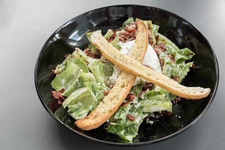 caesar salad: bowl of green caesar salad