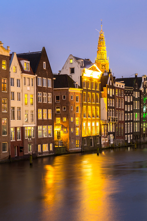 nicholas: Amsterdam Canals and Saint Nicholas church at dusk Netherlands