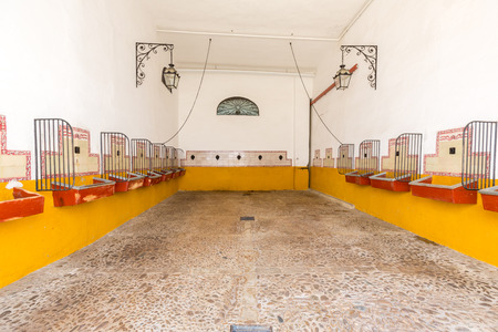 toros: empty bull stable in bullfight arena, plaza de toros, Sevilla, Spain