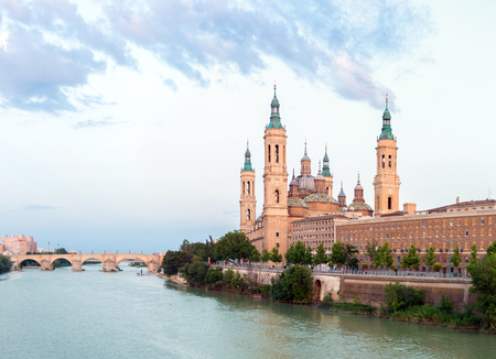 basilica: Our Lady of the Pillar Basilica with Ebro River at dusk Zaragoza, Spain Stock Photo