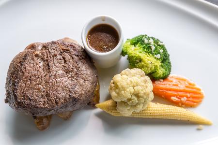 medium close up: Grilled beef steak tenderloin with vegetable Stock Photo