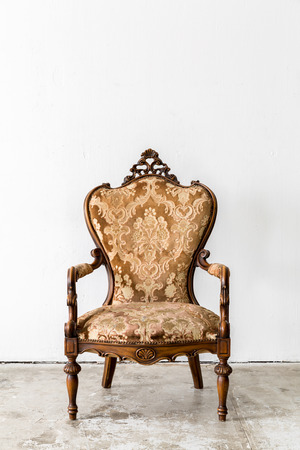 the royal: Brown Royal classical style Armchair sofa couch in vintage room Stock Photo