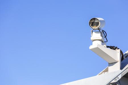 deterrent: CCTV security camera over blue sky Stock Photo