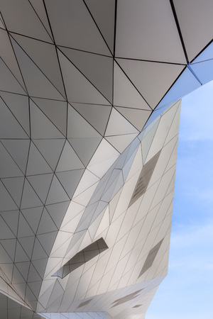 curved: Modern building with curving roof for background Stock Photo