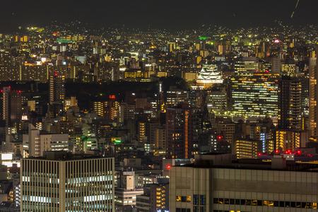 skylines: Osaka castle with Skylines building at night Japan