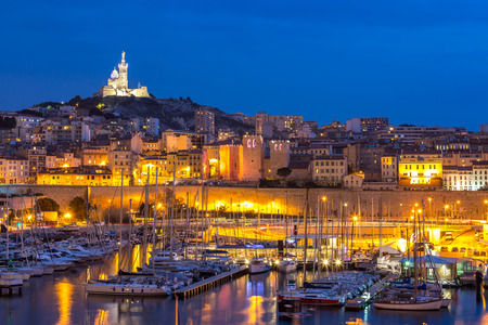 garde: Marseille, France at night. The famous european harbour view on the Notre Dame de la Garde