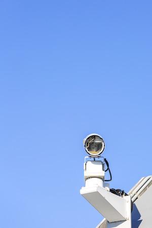 security technology: CCTV security camera over blue sky Stock Photo