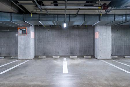cement wall: empty Parking garage underground, interior shopping mall at night Stock Photo