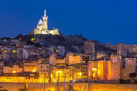 harbour: Marseille, France at night. The famous european harbour view on the Notre Dame de la Garde
