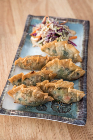 potstickers: Korean Style Gyoza, Vegeterian Potstickers with soy sauce and pork