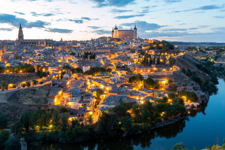 toledo town: Toledo Cityscape with Alcazar at dusk in Madrid Spain Stock Photo