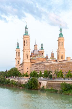 ebro: Our Lady of the Pillar Basilica with Ebro River at dusk Zaragoza, Spain Stock Photo