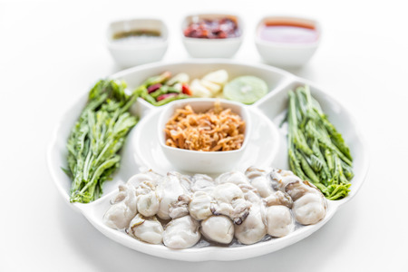 Fresh Oyster serve with assorted vegetable on white background