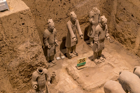 terra cotta: Xian China Historic Restored Terra Cotta Warriors ruin in a museum in Xian. Editorial
