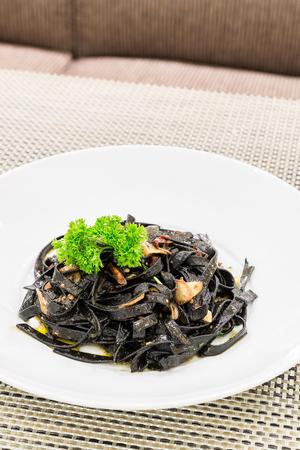 olio: Fresh black aglio olio pasta with garlic and chilli