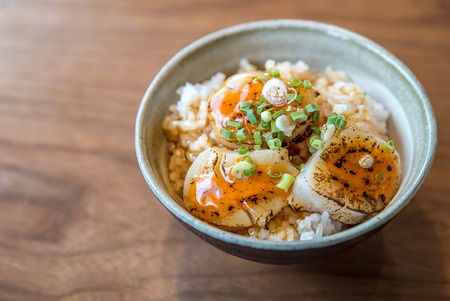 uni: Hotate on rice with uni sauce, Grilled fried scallop rice, gourmet japanese cuisine.