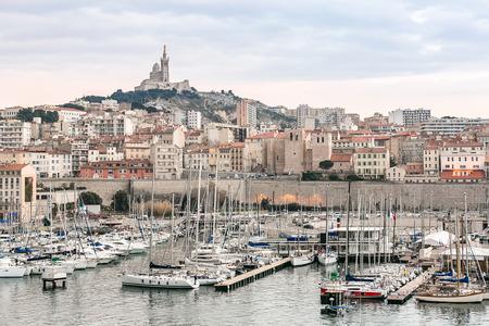 garde: Marseille, France sunset. The famous european harbour view on the Notre Dame de la Garde
