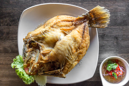fish sauce: deep fried sea bass with fish sauce and spicy salad
