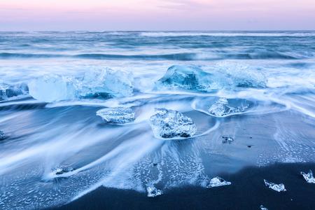 terminus: Iceberg beach at Vatnajokull Glacier Jokulsarlon Iceland sunrise Stock Photo