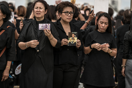 BANGKOK, Thailand - OCT 22: Thai people singing the anthem of His Majesty King Bhumibol Adulyadej on October 22,2016 Bangkok, Thailand. Thailands King, the worlds longest-reigning monarch, has died after 70 years as head of state.
