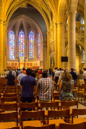 extant: Luxembourg City, Luxembourg - July, 12, 2015 : People during mass in Saint Michaels Church, Luxembourg City on July, 12, 2015. The church is the oldest extant religious site in Luxembourg City.