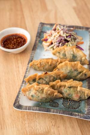 gyoza: Korean Style Gyoza, Vegeterian Potstickers with soy sauce and pork
