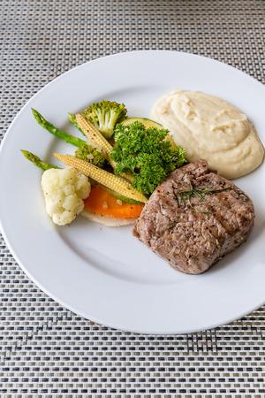 fillet steak: grilled fillet steak served with grilled vegetable and mash potato