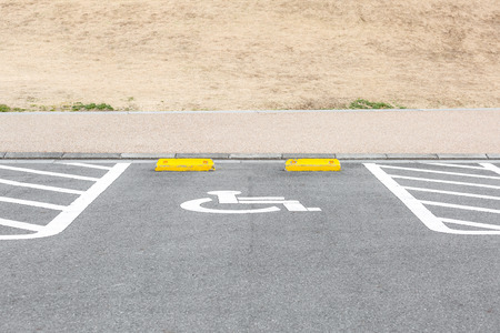 blacktop: Handicapped Parking Spaces in commercial parking lot