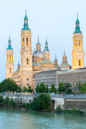 Our Lady of the Pillar Basilica with Ebro River at dusk Zaragoza, Spain Editorial