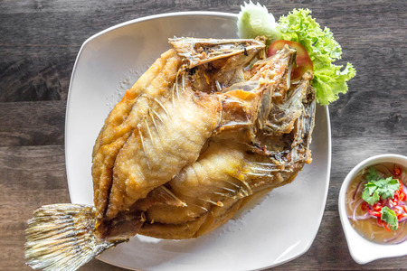 sea bass: deep fried sea bass with fish sauce and spicy salad