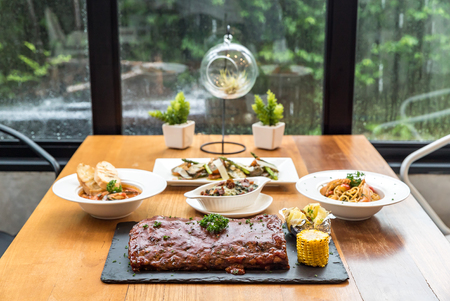 restaurant dining: dining table with food ready to eat