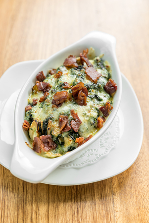 Baked spinach with cheese and becon