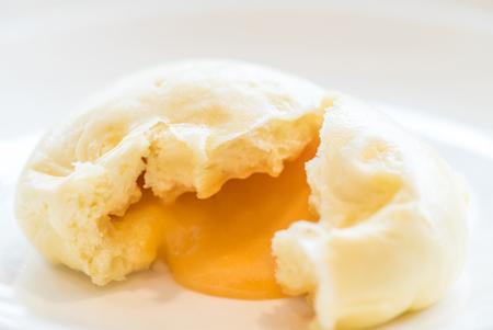 Chinese dim sum yolk lava Bun - Steamed Chinese groumet cuisine