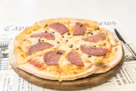 Italian Pepperoni pizza with salami Italian traditional food. Popular street food. Stock Photo