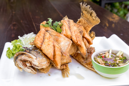 Sea bass fried with fish sauce with spicy mango sauce Stock Photo