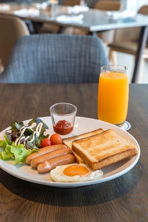 Breakfast sausage set with fried egg and orange juice Stock Photo