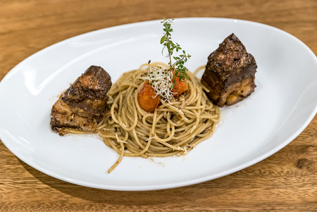 Spaghetti pasta with Pork Belly Thai southern style Stock Photo