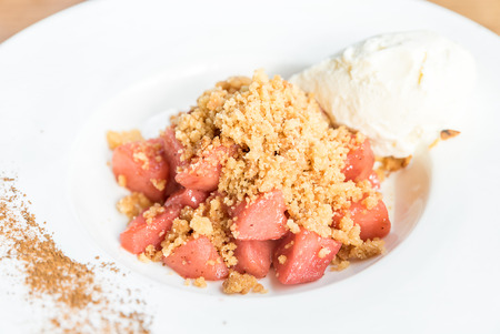 apple crumble with Icecream and cinnamon powder Stock Photo